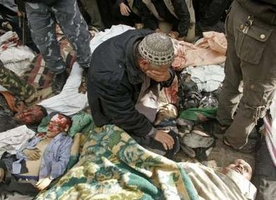 Gazan father weeps before dead son
