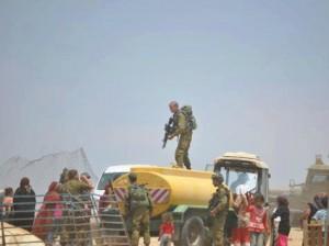 IOF steal Palestinian water tanks
