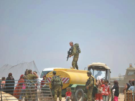IOF steal Palestinian water tanks